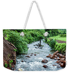 Weekender Tote Bag featuring the photograph Stream by Charuhas Images