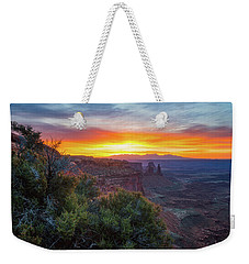Weekender Tote Bag featuring the photograph Sunrise Over Canyonlands by Darren White