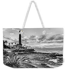 Weekender Tote Bag featuring the photograph Sunset At Chipiona Lighthouse Cadiz Spain by Pablo Avanzini