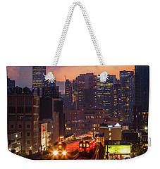 Weekender Tote Bag featuring the photograph The City That Never Sleeps by Anthony Fields