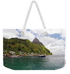 Weekender Tote Bag featuring the photograph The Pilons by Gary Wonning