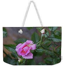 Weekender Tote Bag featuring the photograph The Rose by John Kolenberg