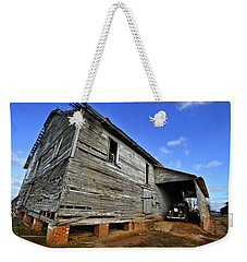 Weekender Tote Bag featuring the photograph Time Warp by Laura Ragland