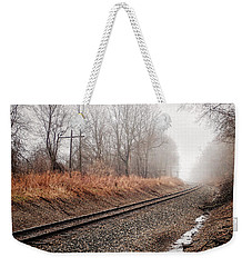 Weekender Tote Bag featuring the photograph Tracks In Morning Fog by Lars Lentz