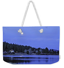 Weekender Tote Bag featuring the photograph Under A Winter Moon by Nancy Marie Ricketts