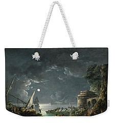 View Of A Moonlit Mediterranean Harbor Weekender Tote Bag by Carlo Bonavia