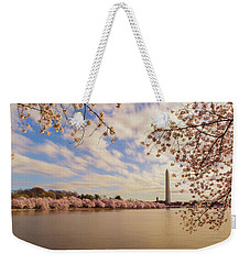 Weekender Tote Bag featuring the photograph Washington Monument And Cherry Blossom by Rima Biswas