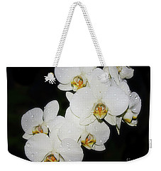 Weekender Tote Bag featuring the photograph White Orchid by Elvira Ladocki
