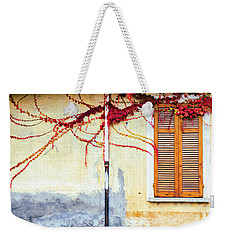 Weekender Tote Bag featuring the photograph Window And Red Vine by Silvia Ganora