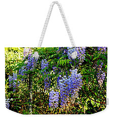 Weekender Tote Bag featuring the photograph Wisteria by Betty-Anne McDonald