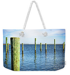 Weekender Tote Bag featuring the photograph Wood Pilings by Colleen Kammerer