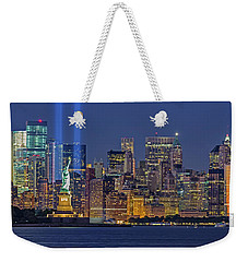 Weekender Tote Bag featuring the photograph World Trade Center Wtc Tribute In Light Memorial II by Susan Candelario