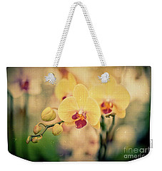 Weekender Tote Bag featuring the photograph Yellow Orchids by Ana V Ramirez