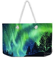 Weekender Tote Bag featuring the photograph Aurora Borealis by Setsiri Silapasuwanchai