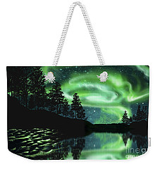 Weekender Tote Bag featuring the photograph Aurora Borealis by Setsiri Silapasuwanchai
