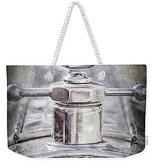 Weekender Tote Bag featuring the photograph 1920 Pierce-arrow Model 48 Coupe Hood Ornament -2829ac by Jill Reger
