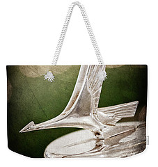 Weekender Tote Bag featuring the photograph 1932 Studebaker Dictator Hood Ornament -0850ac by Jill Reger
