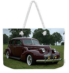 Weekender Tote Bag featuring the photograph 1939 Buick Roadmaster Formal Sedan by Tim McCullough