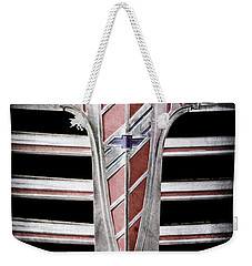 Weekender Tote Bag featuring the photograph 1941 Chevrolet Grille Emblem -0288ac by Jill Reger