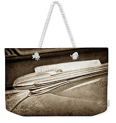 Weekender Tote Bag featuring the photograph 1948 Chevrolet Hood Ornament -0587s by Jill Reger
