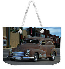 Weekender Tote Bag featuring the photograph 1948 Oldsmobile Sedan Delivery by Tim McCullough