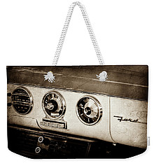 Weekender Tote Bag featuring the photograph 1955 Ford Fairlane Dashboard Emblem -0444s by Jill Reger