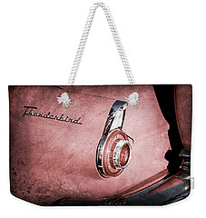 Weekender Tote Bag featuring the photograph 1956 Ford Thunderbird Convertible Taillight Emblem -0361ac by Jill Reger