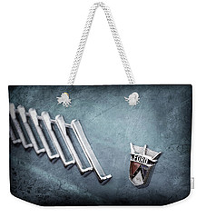 Weekender Tote Bag featuring the photograph 1956 Ford Thunderbird Emblem -0052ac by Jill Reger
