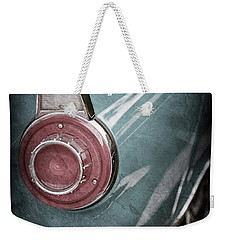 Weekender Tote Bag featuring the photograph 1956 Ford Thunderbird Taillight Emblem -0382ac by Jill Reger
