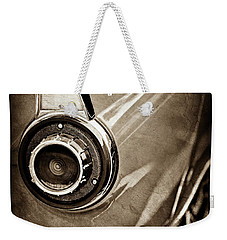 Weekender Tote Bag featuring the photograph 1956 Ford Thunderbird Taillight Emblem -0382s by Jill Reger