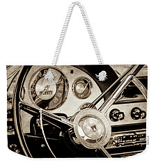Weekender Tote Bag featuring the photograph 1956 Ford Victoria Steering Wheel -0461s by Jill Reger