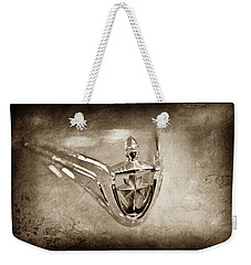 Weekender Tote Bag featuring the photograph 1956 Lincoln Premier Convertible Hood Ornament -0832s by Jill Reger