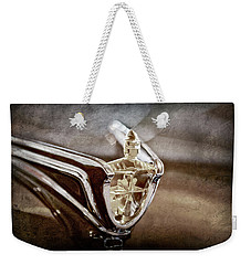 Weekender Tote Bag featuring the photograph 1956 Lincoln Premiere Convertible Hood Ornament -2797ac by Jill Reger