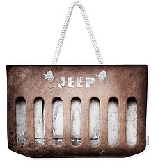 Weekender Tote Bag featuring the photograph 1957 Jeep Emblem -0597ac by Jill Reger