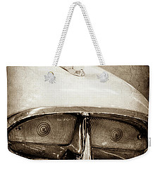 Weekender Tote Bag featuring the photograph 1957 Mercury Turnpike Cruiser Emblem -0749s by Jill Reger