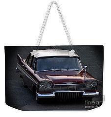 Weekender Tote Bag featuring the photograph 1957 Plymouth Belvedere by Baggieoldboy