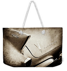 Weekender Tote Bag featuring the photograph 1958 Cadillac Eldorado Biarritz Taillight Emblems -0255s by Jill Reger