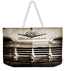 Weekender Tote Bag featuring the photograph 1959 Chevrolet Impala Grille Emblem -1014s by Jill Reger