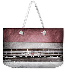 Weekender Tote Bag featuring the photograph 1961 Chevrolet Corvair Pickup Truck Grille Emblem -0130ac by Jill Reger