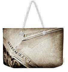 Weekender Tote Bag featuring the photograph 1962 Oldsmobile Hood Ornament And Emblem -0598s by Jill Reger