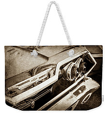 Weekender Tote Bag featuring the photograph 1963 Chevrolet Taillight Emblem -0183s by Jill Reger