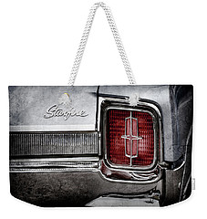 Weekender Tote Bag featuring the photograph 1965 Oldsmobile Starfire Taillight Emblem -0212ac by Jill Reger