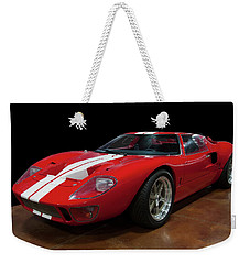 Weekender Tote Bag featuring the photograph 1966 Ford Gt 40 by Chris Flees