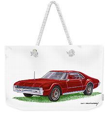 Weekender Tote Bag featuring the painting 1966 Oldsmobile Toronado by Jack Pumphrey