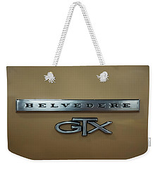 Weekender Tote Bag featuring the photograph 1967 Plymouth Belvedere Gtx Front Quarter Pannel by Chris Flees