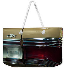Weekender Tote Bag featuring the photograph 1967 Plymouth Belvedere Gtx Rear Tail Light by Chris Flees