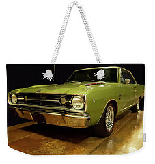 Weekender Tote Bag featuring the photograph 1968 Dodge Dart Gts by Chris Flees
