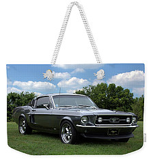 Weekender Tote Bag featuring the photograph 1967 Mustang Fast Back by Tim McCullough
