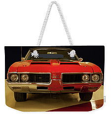 Weekender Tote Bag featuring the photograph 1969 Oldsmobile 442 W-30 by Chris Flees