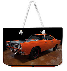 Weekender Tote Bag featuring the photograph 1969 Plymouth Road Runner A12 by Chris Flees